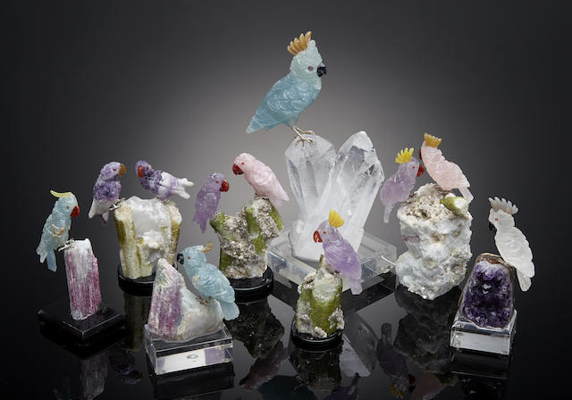 A group of eight carved gemstone cockatoos