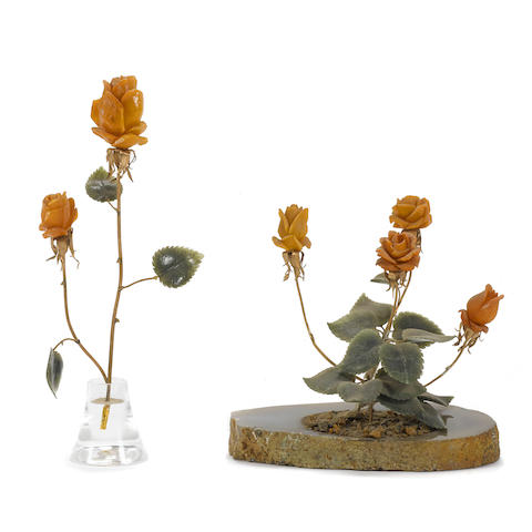 Three carved-stone floral sculptures