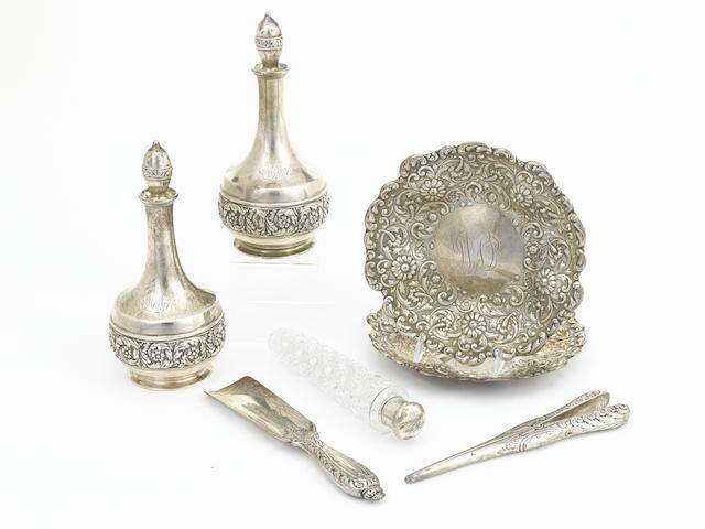 An assembled group of seven American sterling silver and cut-glass vanity articles