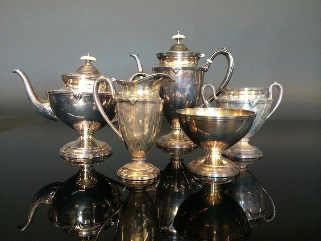 A George III style silverplate five-piece tea and coffee service