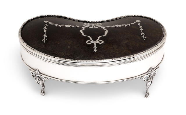 A George V tortoiseshell mounted sterling silver kidney-form jewelry box