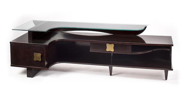 A Julius Rindler mahogany and glass asymmetrical table