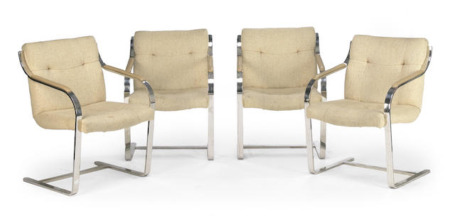 A set of four Modern upholstered flat bar chromed steel and leather armchairs