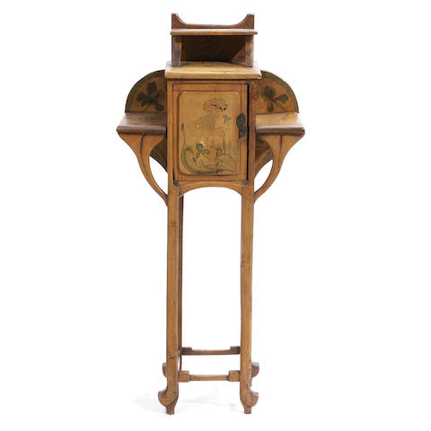 An Art Nouveau fruitwood cabinet with pyrographic decoration