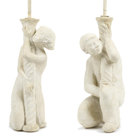 A pair of plaster figural table lamps