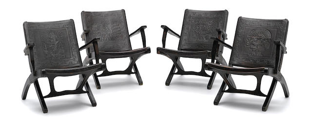 A set of four Modern tooled leather and wood chairs