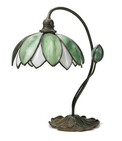 A Handel glass and patinated metal Lotus lamp