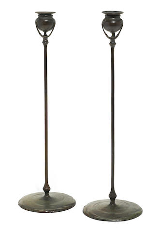 A pair of Tiffany Studios patinated bronze candlesticks