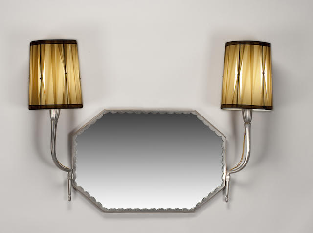 A French Art Deco silvered-bronze two-arm mirrored sconce