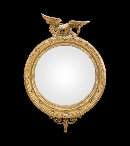A large Regency giltwood girandole mirror