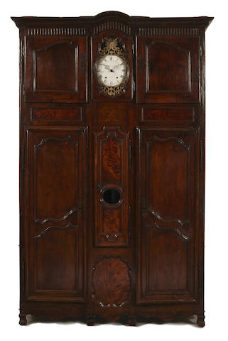A Louis XV walnut and marquetry cupboard inset with a clock