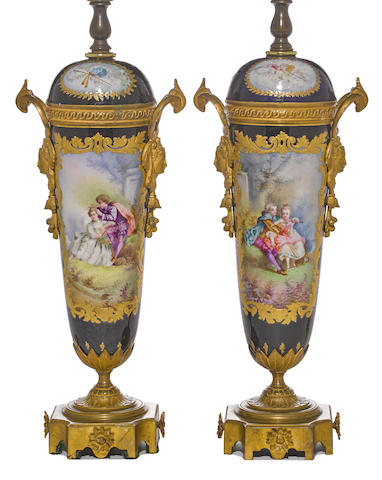 A pair of Sevres style porcelain gilt bronze mounted covered vases