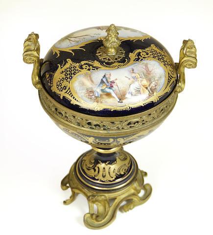 A Sèvres style porcelain gilt bronze mounted potpourri