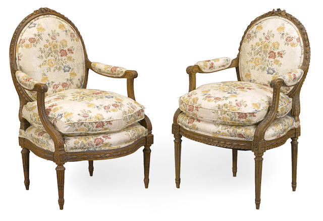 Two Louis XVI carved beechwood fauteuils