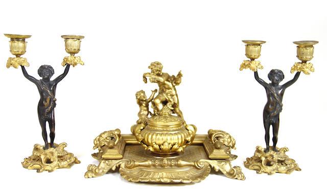 Three gilt bronze table accessories