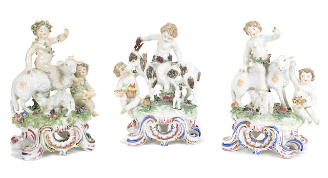 A group of three Continental porcelain figural groups