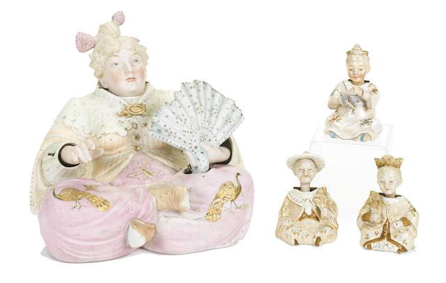 A group of four Continental porcelain nodding head pagoda figures