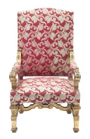 A Régence style carved and gilt throne chair