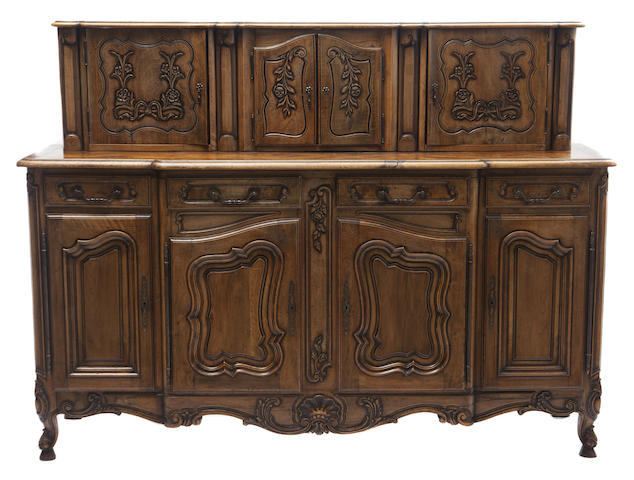 A French Provincial style two part four door buffet