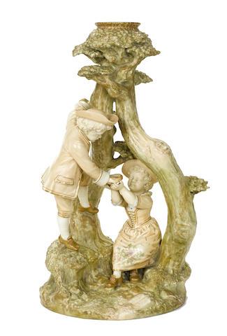 A Royal Worcester porcelain figural group
