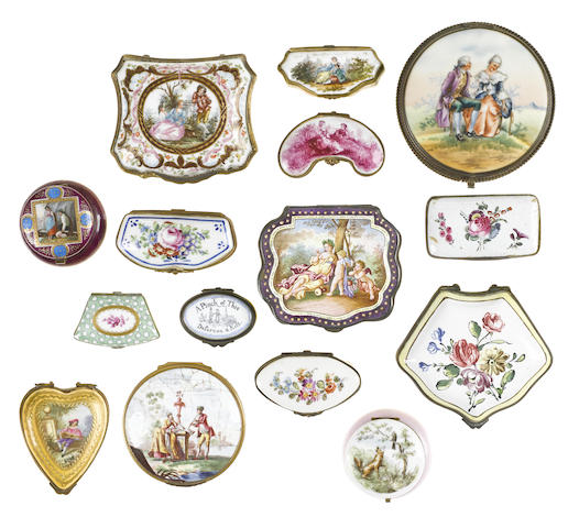 A collection of porcelain and enamel boxes