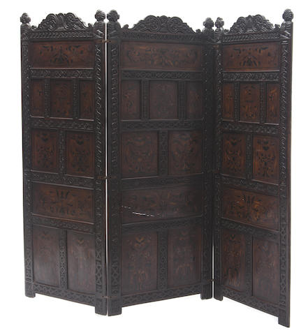 An Jacobean style carved and inlaid three panel screen