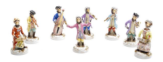 A set of eight Sevres style porcelain monkey band