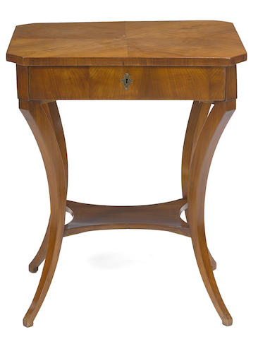 A Continental Neoclassical fruitwood center table
