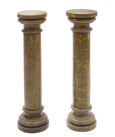 A pair of variegated brown marble columns