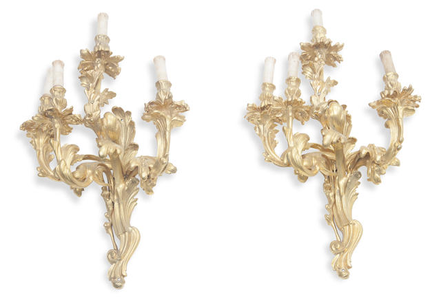 A pair of Louis XV style gilt bronze four light wall sconces