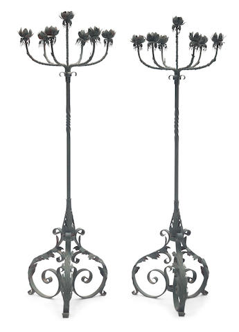 A pair of Spanish Renaissance style wrought iron and tole floor torcheres