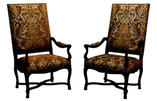 A pair of Regence style carved walnut floral upholstered armchairs