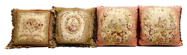 A group of four tapestry upholstered pillows
