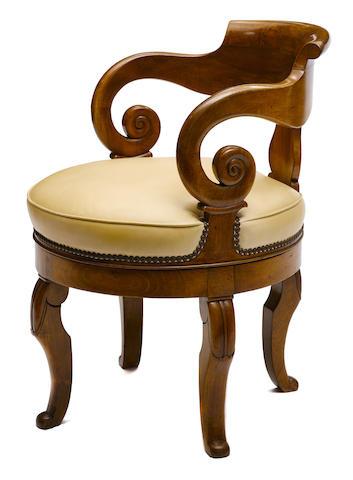A Charles X walnut swivel armchair