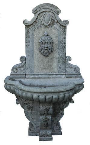 An Italian carved marble three part wall fountain