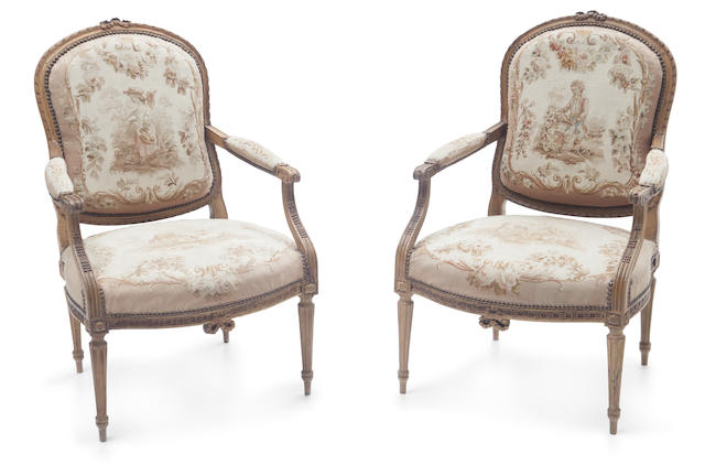 A pair of Louis XVI style tapestry upholstered armchairs