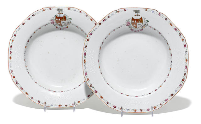 A pair of Chinese Export porcelain armorial soup plates