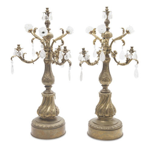 A pair of French gilt bronze rock crystal prism seven light candelabra