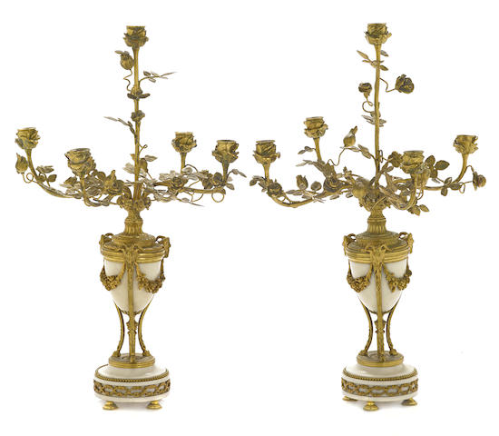 A pair of Louis XVI style gilt bronze and marble five light candelabra