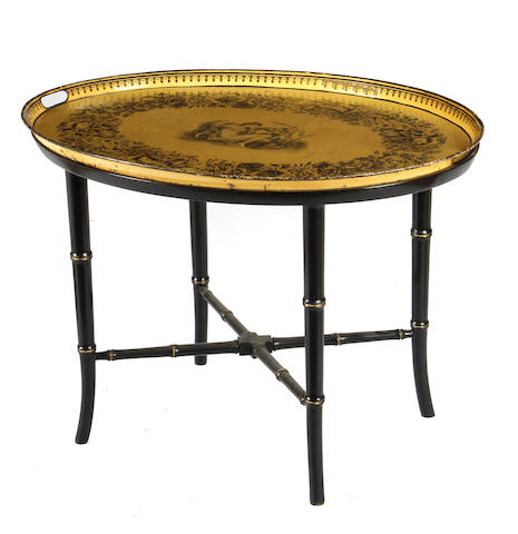 A French tole oval tray on later faux bamboo stand