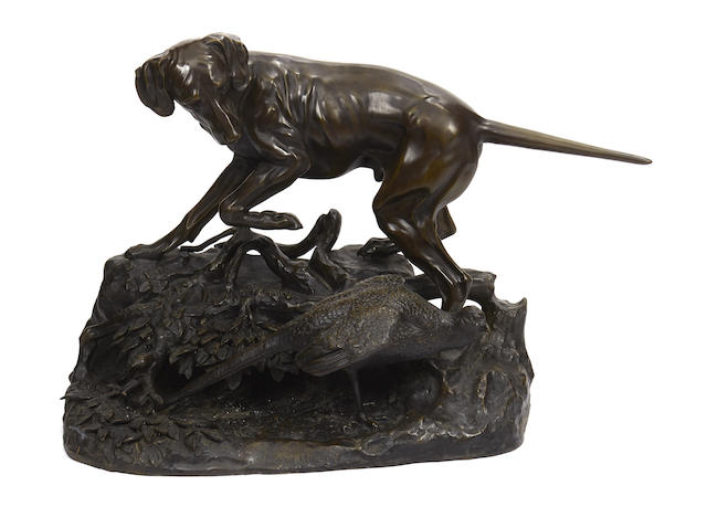 A patinated bronze figure of a dog with pheasant