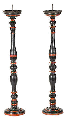 A pair of Italian Baroque paint decorated wood pricket candlesticks