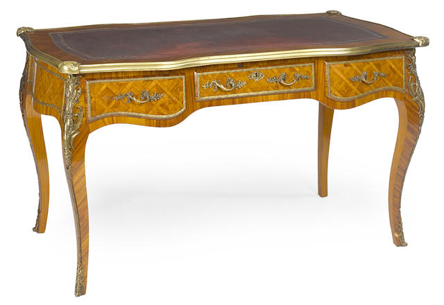 A Louis XV style gilt bronze mounted walnut writing table