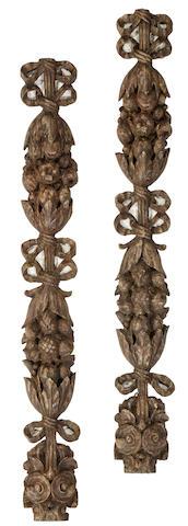 A pair of Baroque style oak pendant appliques