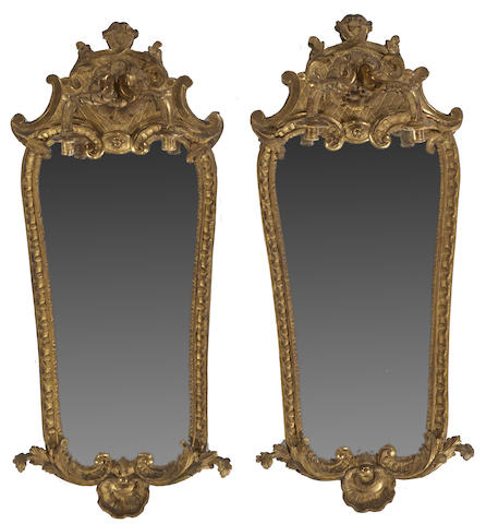 A pair of Italian Baroque style giltwood girandole mirrors