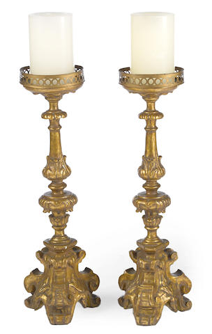 A pair of Baroque style giltwood and gesso candle prickets