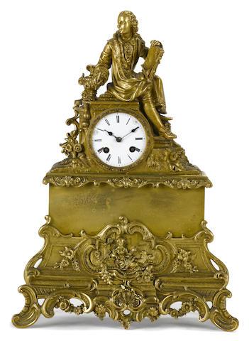 A French gilt bronze figural mantel clock