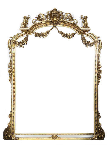 A Louis XVI style gilded figural mirror