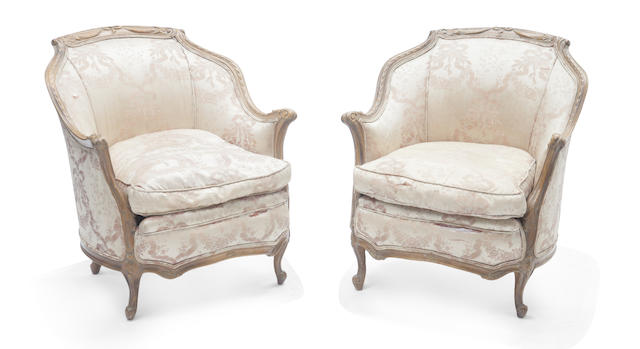 A pair of French silk upholstered bergeres