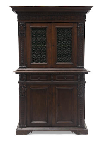 A Italian Renaissance style iron mounted two part cabinet
